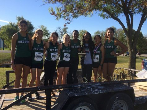 Girls varsity team standing with there runner up trophy