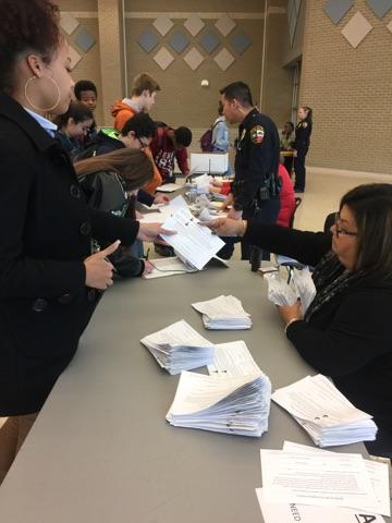 Mrs. Sanchez distributes exemptions to students.