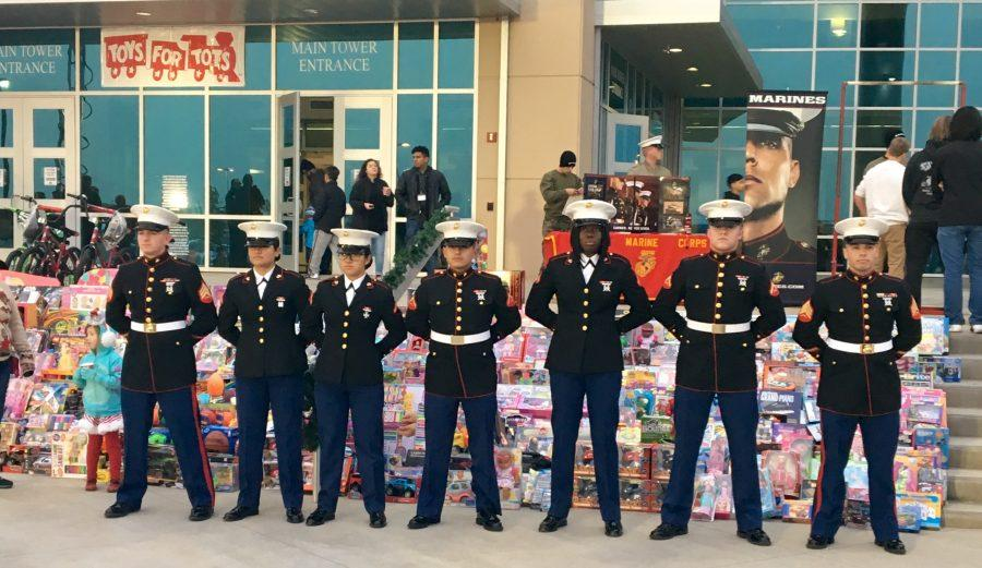 Marine+Corps+stand+at+ease+during+Toys+for+Tots