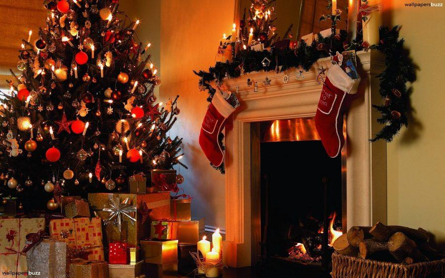 A+family+hangs+stockings+by+a+fireplace+for+Santa+to+fill.+