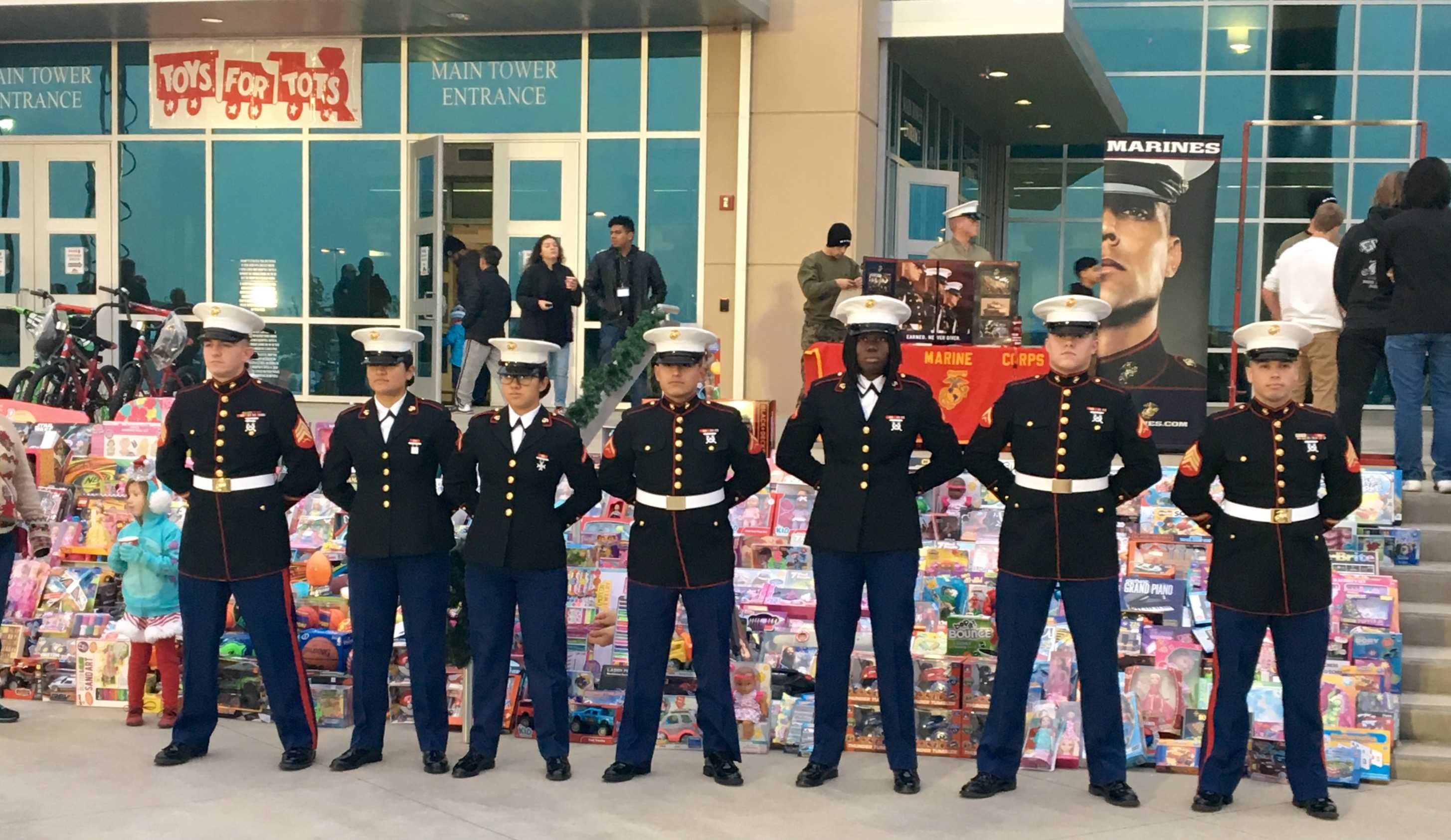 Marine Corps stand at ease during Toys for Tots