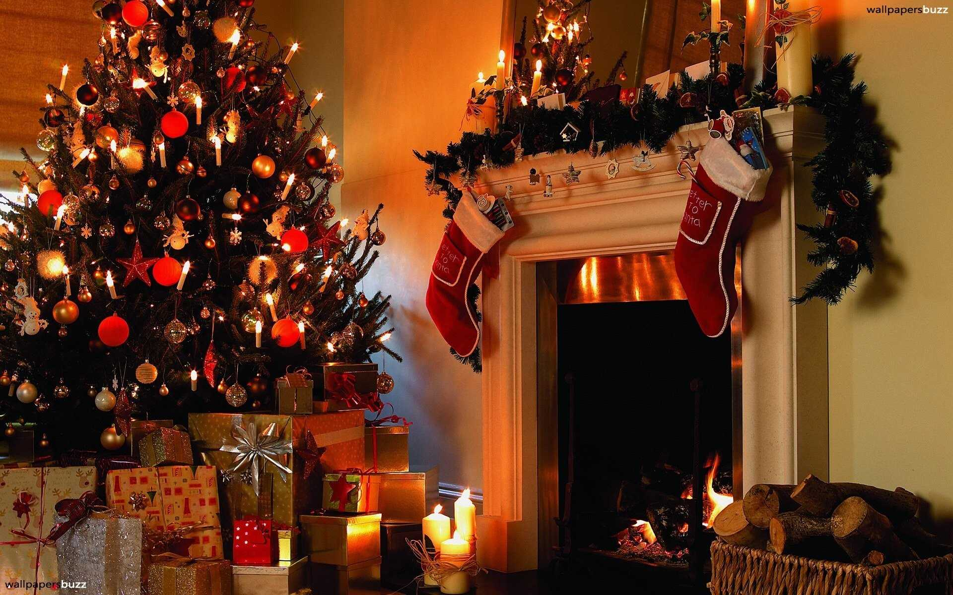 A family hangs stockings by a fireplace for Santa to fill.