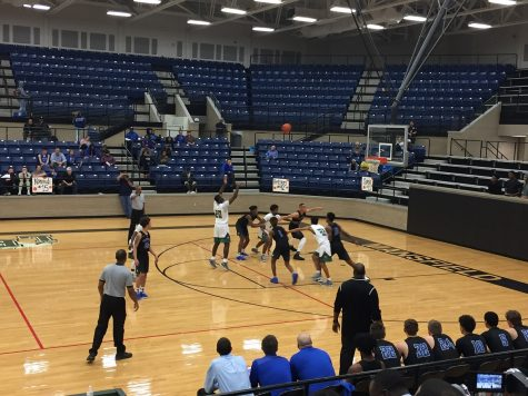 The Lake Ridge Basketball Team shoots a free throw.