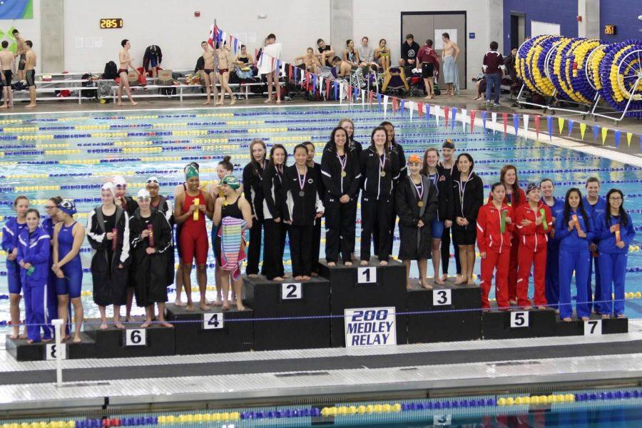 The+LRHS+Girls+Swim+Team+takes+their+place+on+the+podium.
