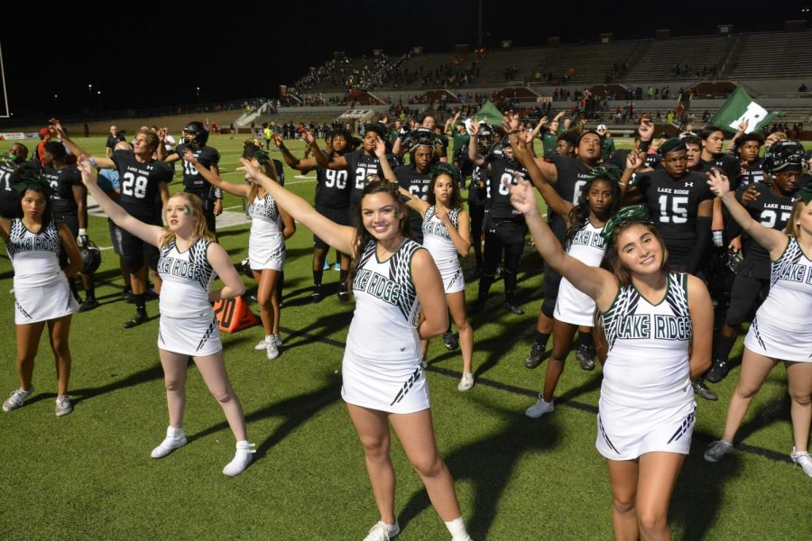 Cheerleaders celebrate after a victory.