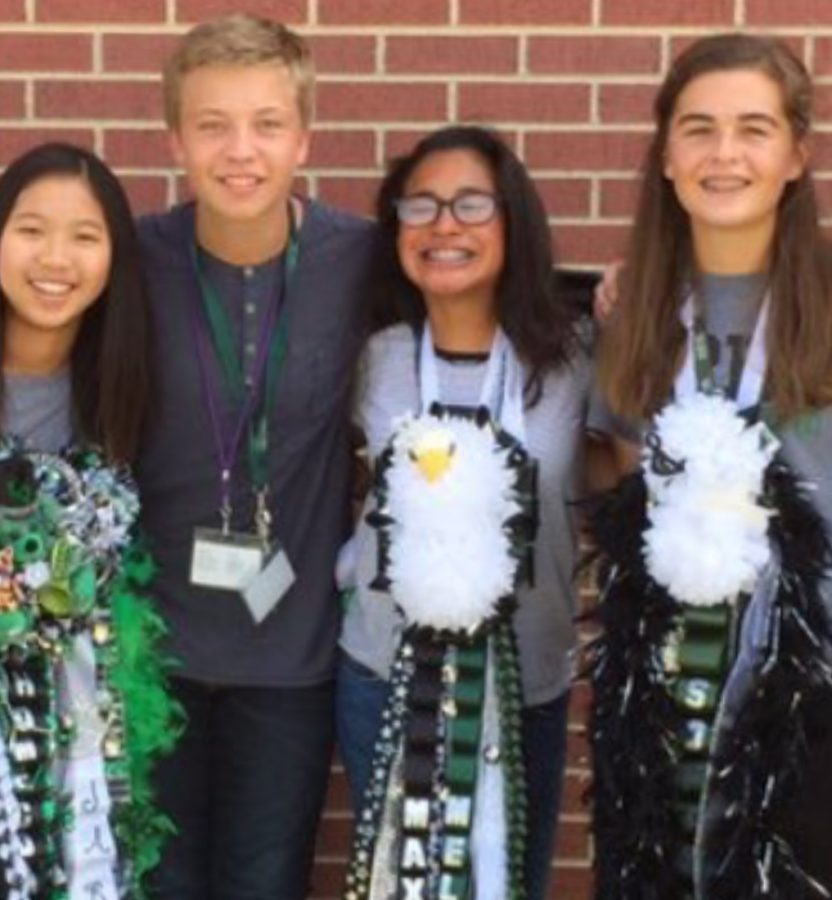 Melanie Perez (third from left) poses with friends for homecoming