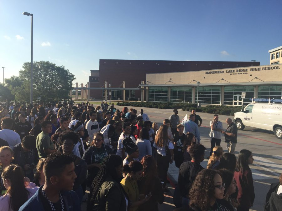 Lake Ridge students gather outside on Monday during a fire drill.