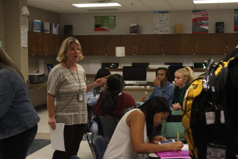 Kristi Canon teaching her Yearbook class, is excited to be at Lake Ridge.