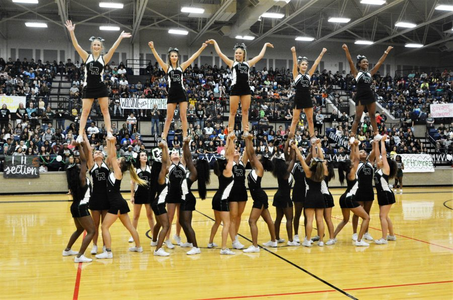 The Lake Ridge cheerleaders perform during a school pep rally.