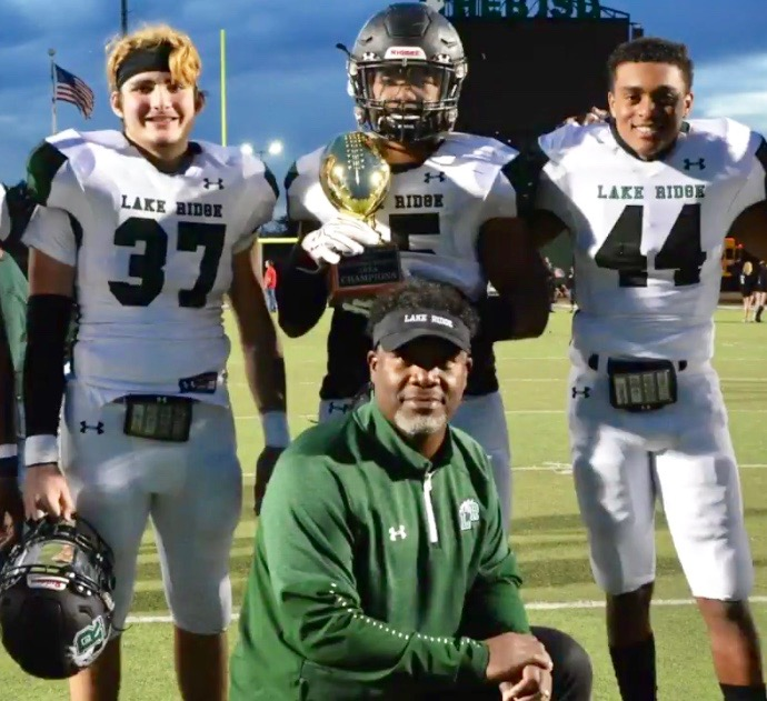 Coach Smith poses with a few of his players after a playoff victory.