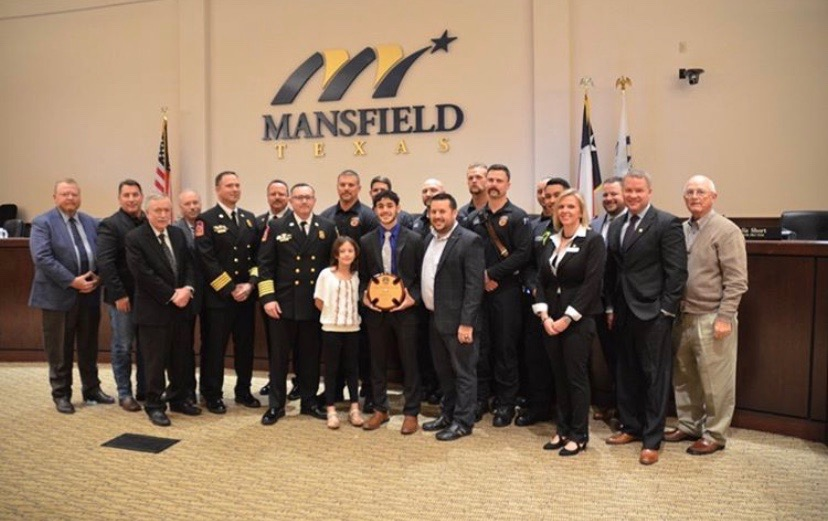 Senior Gabe Vivoni is recognized by the Mansfield City Council for his heroic actions.