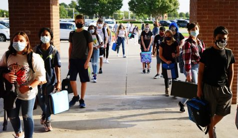 Students line up to enter Danny Jones on the first day of in-person classes. Hand sanitizer stations were set up for students to use as they entered the building.
