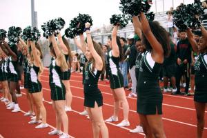Cheerleaders cheer on students during the outdoor clapout