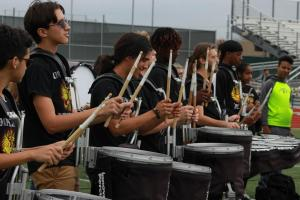 The drum line plays cadences to hype up students during pep rallies and clapouts